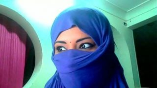 A covered face muslim shows her breasts